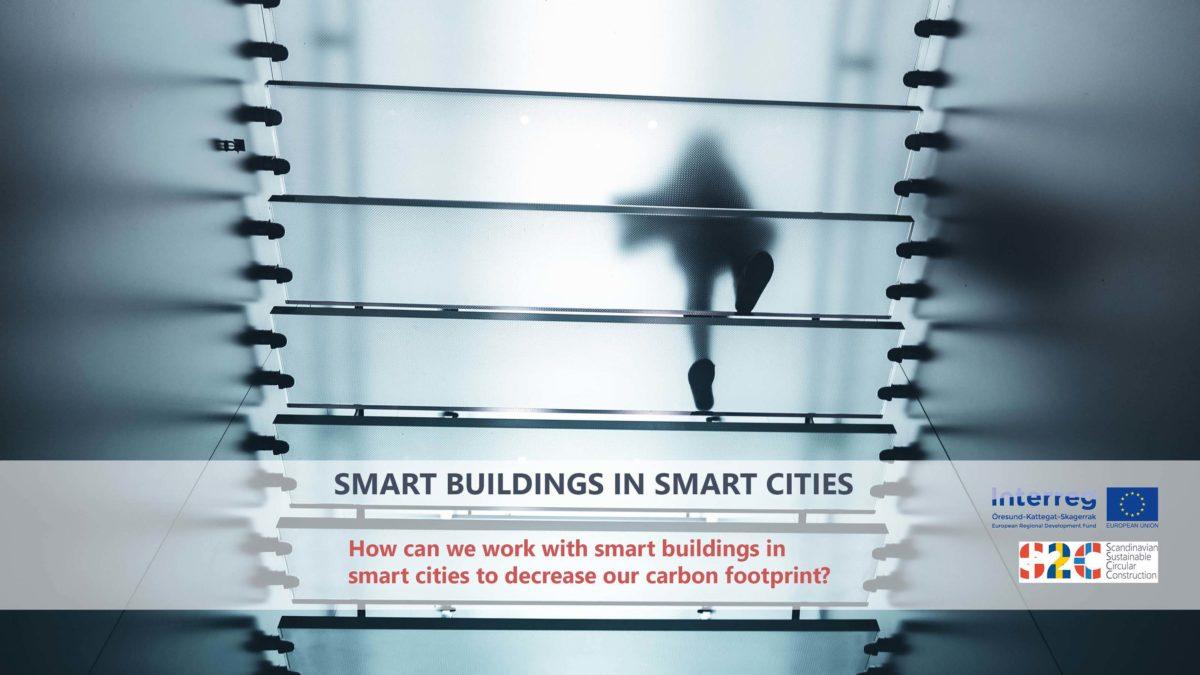 Suddig bild tagen underifrån en trappa när en person går uppför den. Texten Smart buildings in smart cities, how can we work with smart buildings in smart cities to decrease our carbon footprint?